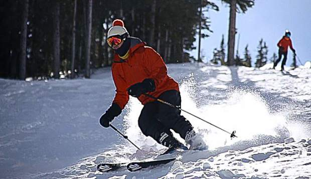 A skier makes turns on Aspen Mountain Saturday for opening day.