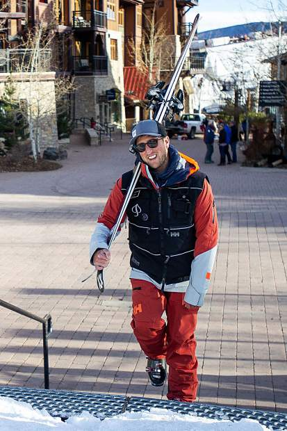 Andy Curtis gets ready to hit the slopes at Base Village in Snowmass for opening day Thursday.