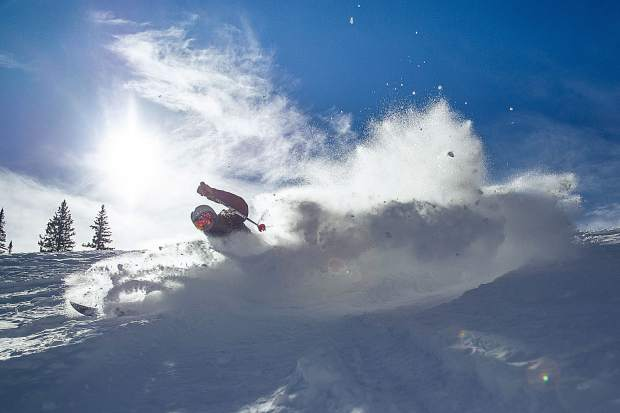 Bear Bolduc slashes through some powder on Snowmass Mountain for opening day Thursday.