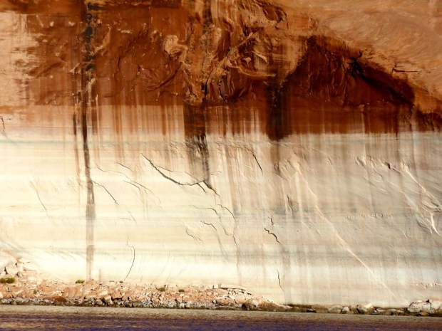 The increasingly familiar bathtub ring in Lake Powell, which is below 50 percent full and dropping.