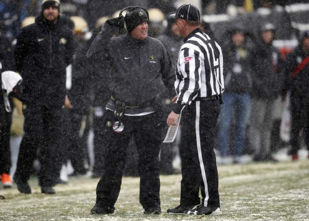 Colorado head coach Mike MacIntyre, left, confers with line judge Steven Kovac in the first half of an NCAA college football game against Utah, Saturday, Nov. 17, 2018, in Boulder, Colo. (AP Photo/David Zalubowski)