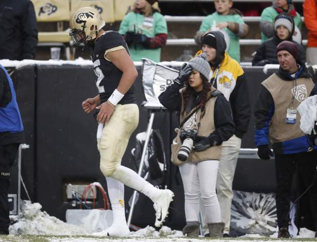 Colorado quarterback Steven Montez tests his right leg on the sideline after being sacked by three Utah defends in the second half of an NCAA college football game Saturday, Nov. 17, 2018, in Boulder, Colo. Montez did not return to the game. Utah won 30-7. (AP Photo/David Zalubowski)