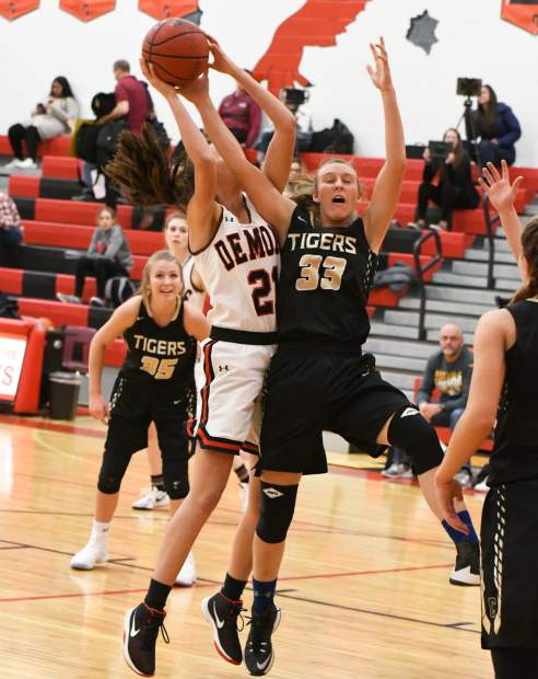Glenwood Springs Demon Graci Dietrich attempts to score during Friday night's game against the Canon City Tigers.