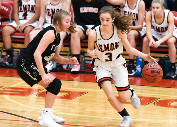 Glenwood Springs Demon Emily Worline dribbles the ball around the defending Canon City Tiger during Friday night's game at Glenwood Springs High School.