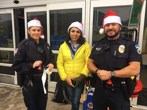 Not to be outdone officers Shelby McNeal and Jose Valadez were out representing the Rifle Police Department along with Nubia Verdin-Hernandez of the Salvation Army.