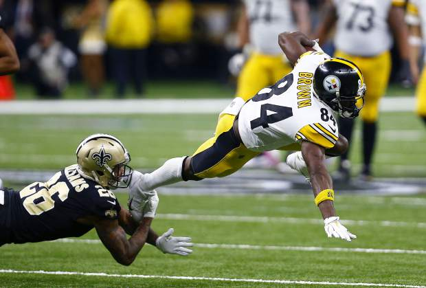 Pittsburgh Steelers wide receiver Antonio Brown (84) is tripped up by New Orleans Saints cornerback P.J. Williams (26) on a pass reception in the second half of an NFL football game in New Orleans, Sunday, Dec. 23, 2018. (AP Photo/Butch Dill)
