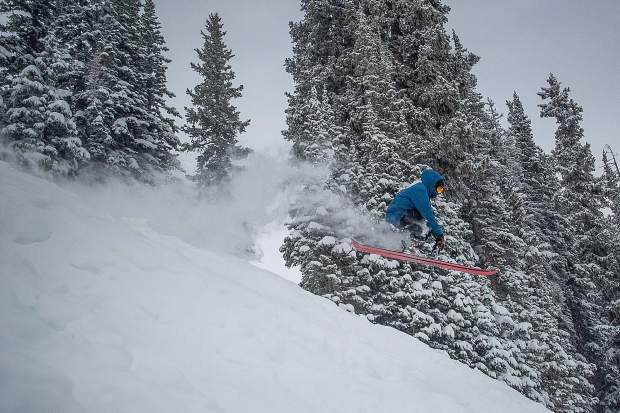 Bryan Brown gets air skiing at Aspen Highlands for opening day Saturday.