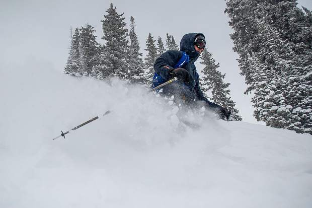 Sam skis through powder at Aspen Highlands for opening day on Saturday.