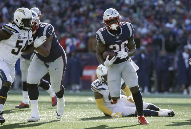 New England Patriots running back Sony Michel heads for the goal line and his second touchdown during the first half of an NFL divisional playoff football game against the Los Angeles Chargers, Sunday, Jan. 13, 2019, in Foxborough, Mass. (AP Photo/Elise Amendola)
