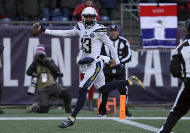 Los Angeles Chargers wide receiver Keenan Allen scores a touchdown against the New England Patriots during the first half of an NFL divisional playoff football game, Sunday, Jan. 13, 2019, in Foxborough, Mass. (AP Photo/Charles Krupa)