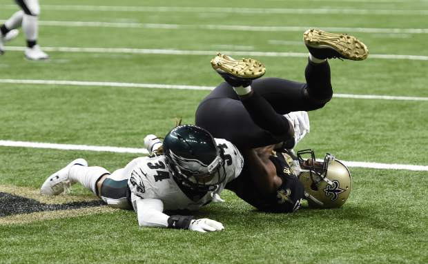 New Orleans Saints wide receiver Michael Thomas (13) pulls in a touchdown reception against Philadelphia Eagles cornerback Cre'von LeBlanc (34) in the second half of an NFL divisional playoff football game in New Orleans, Sunday, Jan. 13, 2019. (AP Photo/Bill Feig)