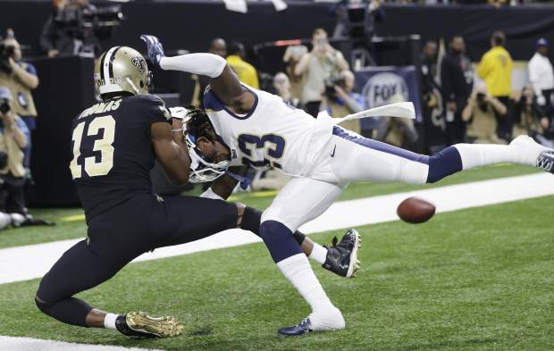 Los Angeles Rams' Nickell Robey-Coleman breaks up a pass intended for New Orleans Saints' Michael Thomas during the second half the NFL football NFC championship game Sunday, Jan. 20, 2019, in New Orleans. (AP Photo/Gerald Herbert)