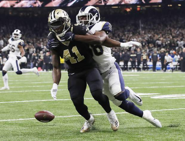 Los Angeles Rams' Cory Littleton breaks up a pass to New Orleans Saints' Alvin Kamara during the second of of half the NFL football NFC championship game, Sunday, Jan. 20, 2019, in New Orleans. (AP Photo/Carolyn Kaster)