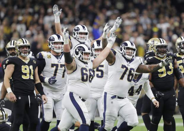 Los Angeles Rams players celebrate after overtime of the NFL football NFC championship game against the New Orleans Saints, Sunday, Jan. 20, 2019, in New Orleans. The Rams won 26-23. (AP Photo/Gerald Herbert)
