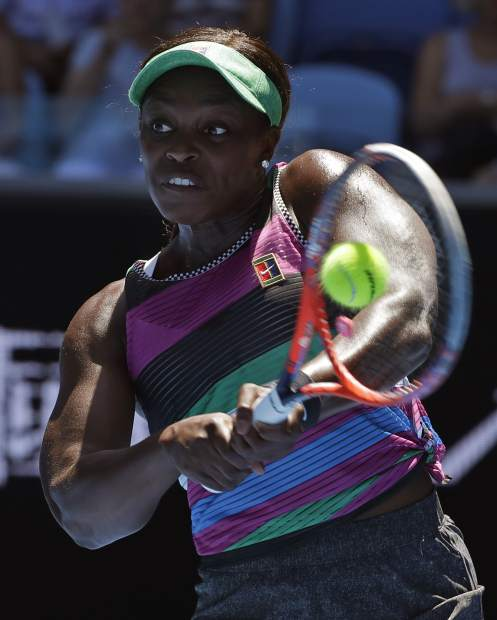 United States' Sloane Stephens makes a backhand return to compatriot Taylor Townsend during their first round match at the Australian Open tennis championships in Melbourne, Australia, Monday, Jan. 14, 2019. (AP Photo/Kin Cheung)
