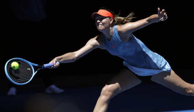 Russia's Maria Sharapova reaches for a forehand return to Britain's Harriet Dart during their first round match at the Australian Open tennis championships in Melbourne, Australia, Monday, Jan. 14, 2019. (AP Photo/Aaron Favila)