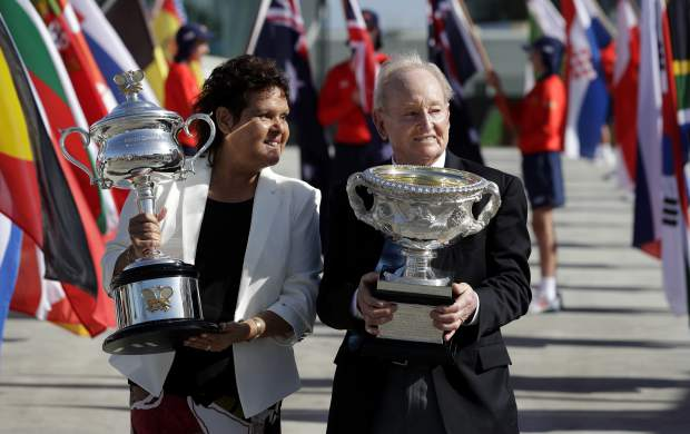 Australian tennis legends Evonne Goolagong Cawley and Rod Laver hold the women's and men's trophies, the Daphne Akhurst Memorial Cup and the Norman Brookes Challenge Cup at the official start of the Australian Open tennis championships in Melbourne, Australia, Monday, Jan. 14, 2019. (AP Photo/Aaron Favila)