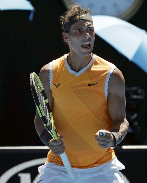 Spain's Rafael Nadal celebrates after defeating Australia's James Duckworth in their first round match at the Australian Open tennis championships in Melbourne, Australia, Monday, Jan. 14, 2019. (AP Photo/Aaron Favila)