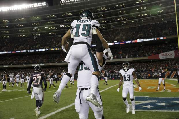 Philadelphia Eagles wide receiver Golden Tate (19) celebrates his touchdown reception with offensive tackle Lane Johnson (65) during the second half of an NFL wild-card playoff football game against the Chicago Bears Sunday, Jan. 6, 2019, in Chicago. (AP Photo/Nam Y. Huh)