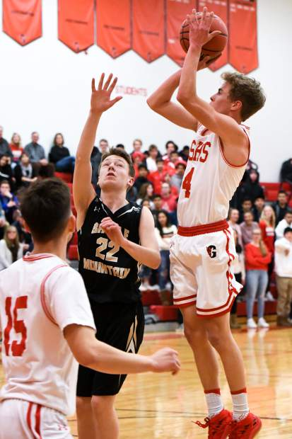 Glenwood Springs Demon Mitchell Burt jumps to score two points during Friday night's game against the Battle Mountain Huskies at Glenwood Springs High School.