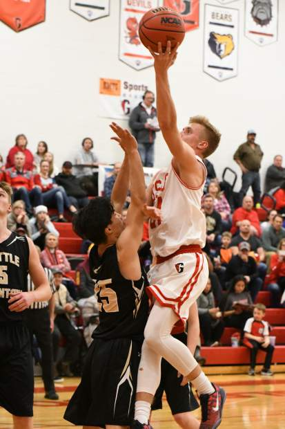 Glenwood Springs Demon Luke Gair jumps for the layup during Friday night's game against the Battle Mountain Huskies at Glenwood Springs High School.
