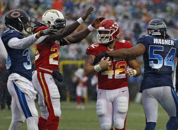 AFC running back Anthony Sherman (42), of the Kansas City Chiefs, celebrates with running back Melvin Gordon III (28), of the Los Angeles Chargers, after scoring against the NFC during the first half of the NFL Pro Bowl football game Sunday, Jan. 27, 2019, in Orlando, Fla. (AP Photo/Mark LoMoglio)