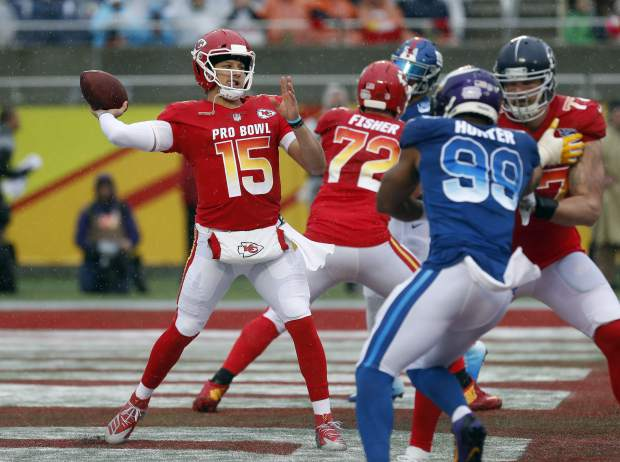 AFC quarterback Patrick Mahomes (15), of the Kansas City Chiefs, throws a pass against the NFC during the first half of the NFL Pro Bowl football game Sunday, Jan. 27, 2019, in Orlando, Fla. (AP Photo/Mark LoMoglio)