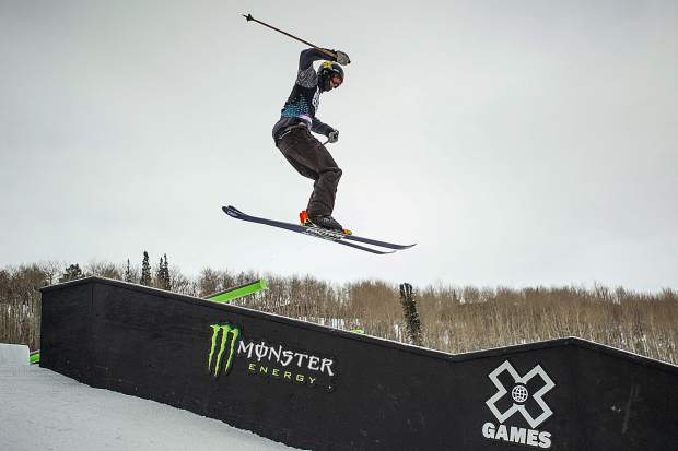 Alex Hall spins onto a box during a practice run before men's ski slopestyle finals at X Games Aspen on Sunday.