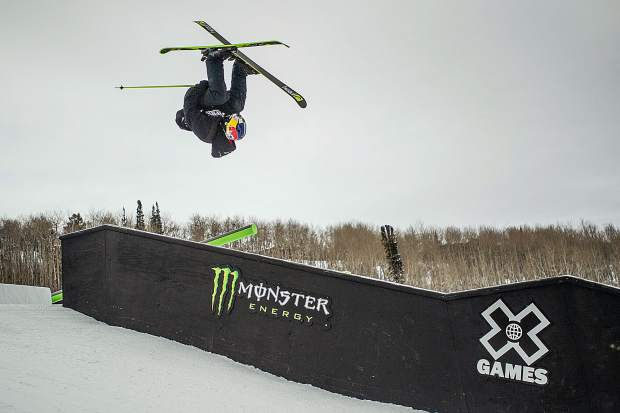 Jesper Tjader flips on a down flat down box for the men's ski slopestyle finals on Sunday at Buttermilk.
