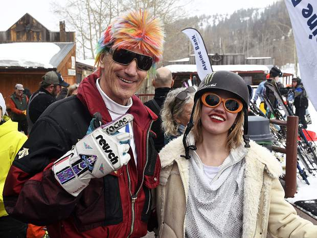 Contestant shows off their outfits after the '80s costume contest during 34th annual Skier Appreciation Day Friday at Sunlight Mountain Resort.