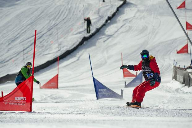 Henry Meece, right, competes against Carson Geiger in the Special Olympics Unified Snowboarding Final at X Games on Thursday. Meece and his partner, Chris Klug, took first place in the event.