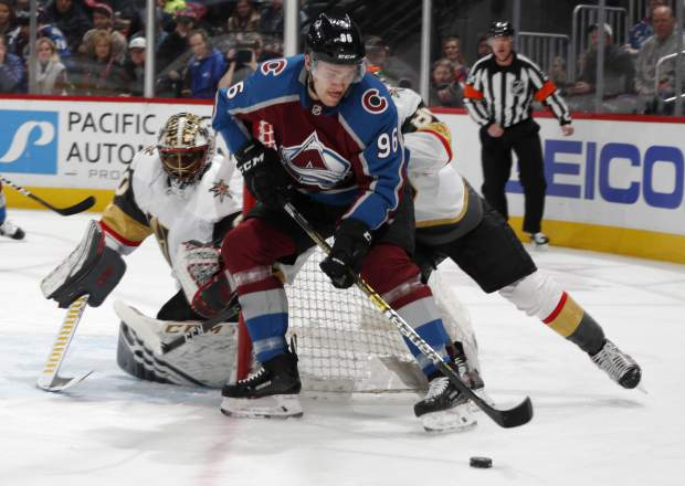 Colorado Avalanche right wing Mikko Rantanen, front, wraps around the net past Vegas Golden Knights defenseman Nate Schmidt to put a shot on goaltender Malcolm Subban in the first period of an NHL hockey game Monday, Feb. 18, 2019, in Denver. (AP Photo/David Zalubowski)