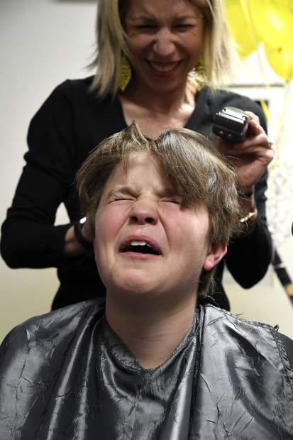 Cooper Luetke reacts after his mom Amy Luetke shaved a chunck of hair from his head Thursday in Glenwood Springs. Members of the Glenwood Grizzly Bantam Hockey team shaved heads for teammate Cooper Cunningham's sister Anna who is battling cancer.