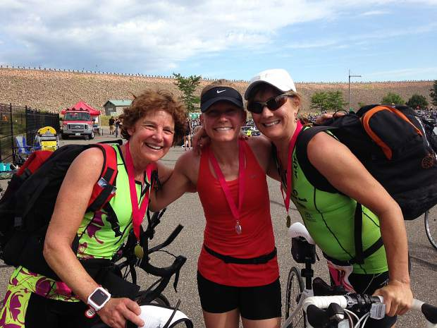 Nancy Reinisch, Lori Boardmen and Heidi Halladay at the finish line at the Tri for the Cure.