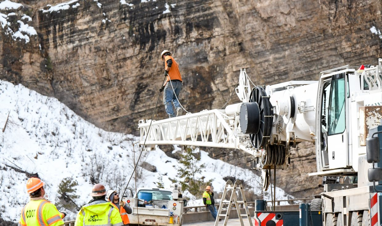 Crews work to assemble a crane on I-70 near Grizzly Creek after an early morning rockslide shut the interstate down in Glenwood Canyon for much of Tuesday morning.