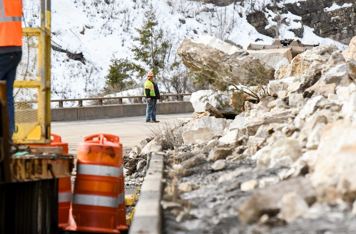 File photo. Large boulders and rocks are piled on the shoulder of I-70 near Grizzly Creek in Glenwood Canyon after an early morning rockslide closed the interstate through Glenwood Canyon in February.