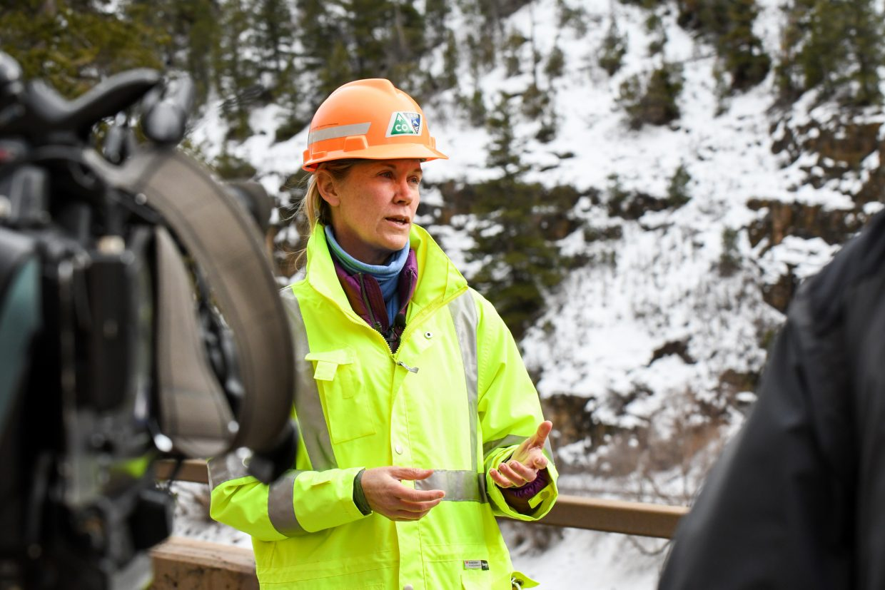 Tracy Trulove with the Colorado Department of Transportation speaks to multiple news stations out of Denver on the site of the early morning rockslide that occurred on I-70 near Grizzly Creek in Glenwood Canyon on Tuesday.