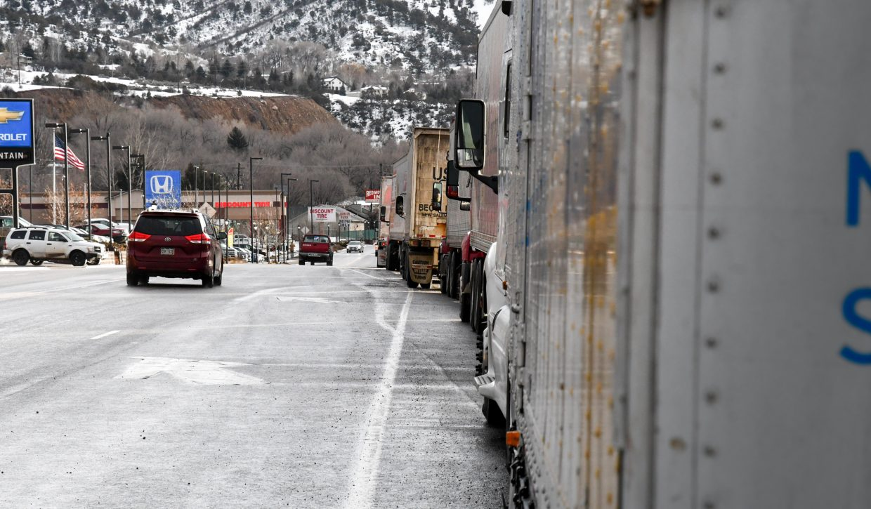 Semis line Highway 6 in West Glenwood on Tuesday morning after an early morning rockslide closed I-70 though Glenwood Canyon.