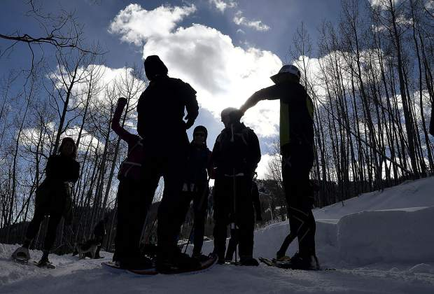 Competitors congregate near the start as they ready for the Sunlight Mountain Snowshoe Shuffle Sunday.
