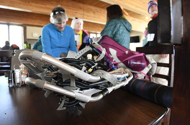 Competitors get their gear ready for the Sunlight Mountain Snowshoe Shuffle Sunday.