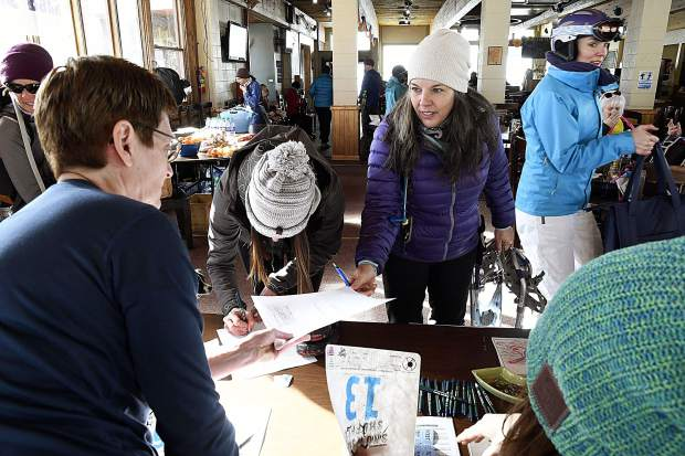 Competitors register and sign-in for the 27th edition of the Sunlight Mountain Snowshoe Shuffle, formerly The Day of Infamy, Sunday at Sunlight Mountain.