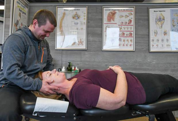 Chiropractor Dr. David Vukelich works with a patient at 180º Wellness located on Midland Avenue.