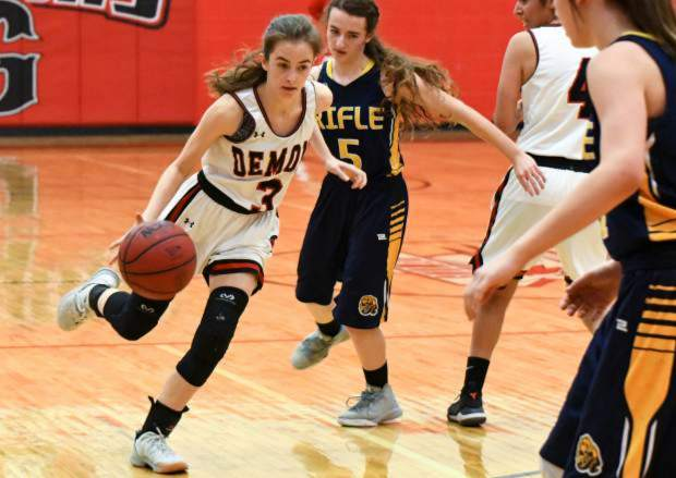 Glenwood senior Emily Worline drives around a pair of Rifle defenders during a home game last season.