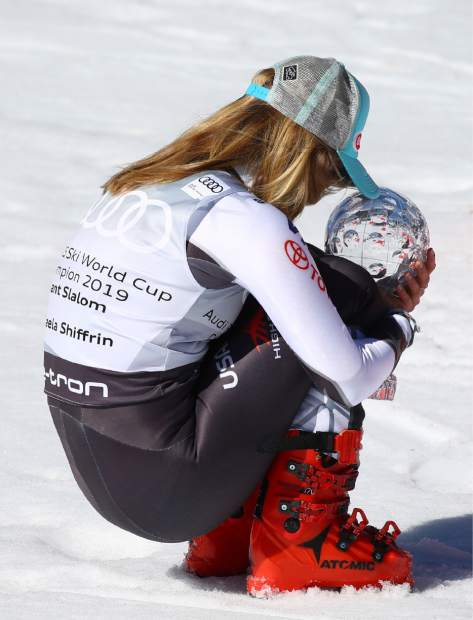 United States' Mikaela Shiffrin holds the trophy for the women's alpine ski giant slalom title, in Soldeu, Andorra, Sunday, March 17, 2019. (AP Photo/Alessandro Trovati)