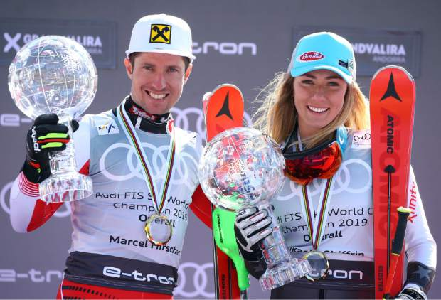 Austria's Marcel Hirscher, left, and United States' Mikaela Shiffrin hold the World Cup overall trophies, at the alpine ski finals in Soldeu, Andorra, Sunday, March 17, 2019. (AP Photo/Alessandro Trovati)
