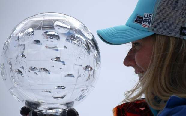 United States' Mikaela Shiffrin holds the women's World Cup overall trophy at the alpine ski, World Cup finals in Soldeu, Andorra, Sunday, March 17, 2019. (AP Photo/Alessandro Trovati)