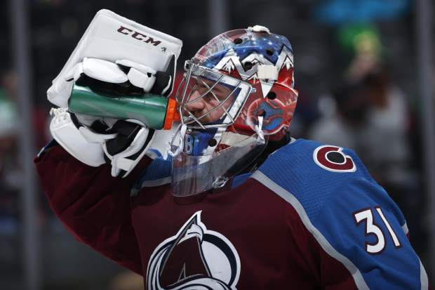 Colorado Avalanche goaltender Philipp Grubauer takes a drink during a timeout during the second period of the team's NHL hockey game against the New Jersey Devils on Sunday, March 17, 2019, in Denver. (AP Photo/David Zalubowski)