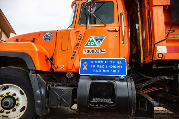 A sign on the side of a CDOT truck honors Eric Hill at Saturday's memorial service.