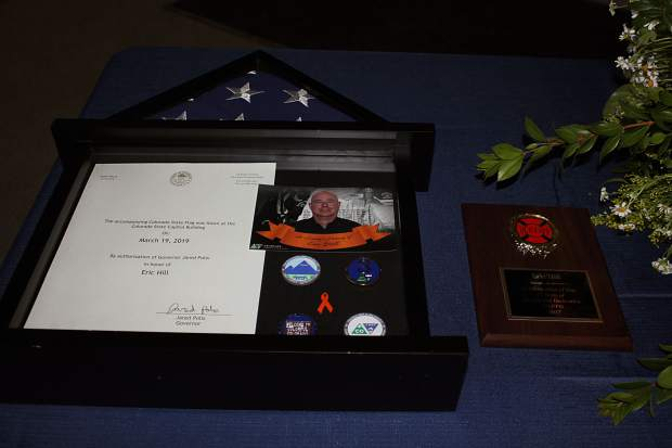 A display case holds an American flag that flew over the Colorado State Capitol On March 19 in honor of Eric Hill.
