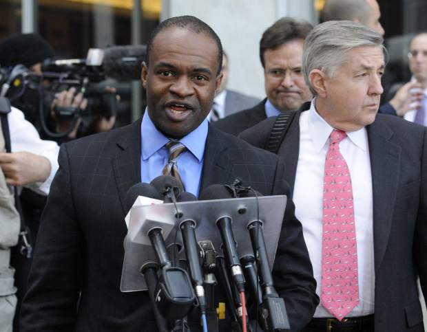 FILE- In this April 6, 2011, file photo DeMaurice Smith, who was head of the NFL Players Association before it dissolved, talks to reporters outside the federal courthouse after a hearing in St. Paul, Minn. At right is players attorney Jim Quinn. Eight years ago, when the NFL was hitting a mere 91 and counting, discord between players and owners reached such a fevered state that the league locked out the union. (AP Photo/Jim Mone, File)